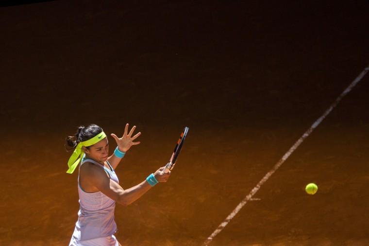 Caroline Garcia from France returns the ball during her Madrid Open tennis tournament match against Karolina Pliskova, from Czech Republic, on Tuesday. (Andres Kudacki/AP)