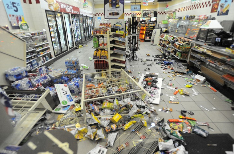 The interior of a looted 7Eleven is seen on St. Paul Street following Saturday's protest. (Jerry Jackson/Baltimore Sun)