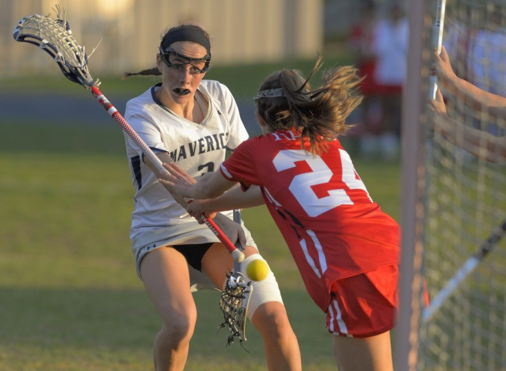 Roland Park's Cameron McGee is late getting to cutting Manchester Valley midfielder, Lizzie Colson as she scores to put the Mavericks up 15-8 in the second half.  Manchester Valley defeated visiting Roland Park in Manchester Wednesday evening, 4/29/15.  ( Doug Kapustin/for BSMG)