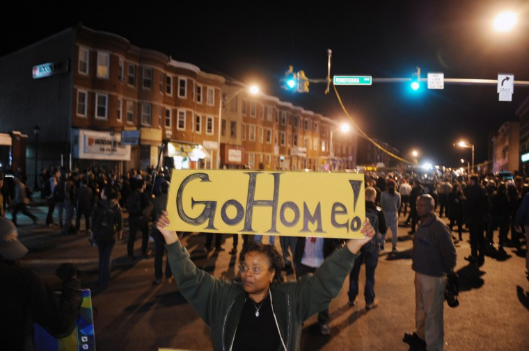 Shawna Eaton pleaded for protesters gathered at the corner of North and Pennsylvania avenues to go home after the 10 p.m. curfew on Tuesday night, a day after a riots and widespread looting in the city. (Kenneth K. Lam/Baltimore Sun)