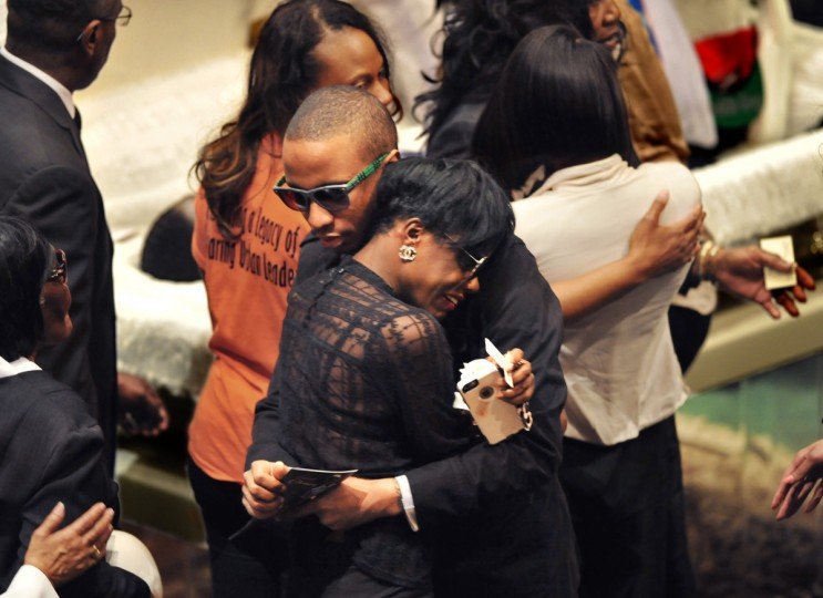 Freddie Gray's twin sister Fredericka Gray, foreground, is comforted by family members at the funeral for her brother.  (Amy Davis/Baltimore Sun)