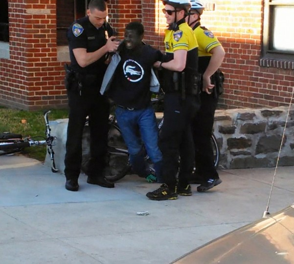 Freddie Gray is seen being taken into custody by Baltimore Police on April 12th in this still from a cell phone video. (Kevin Moore/Special to the Sun)