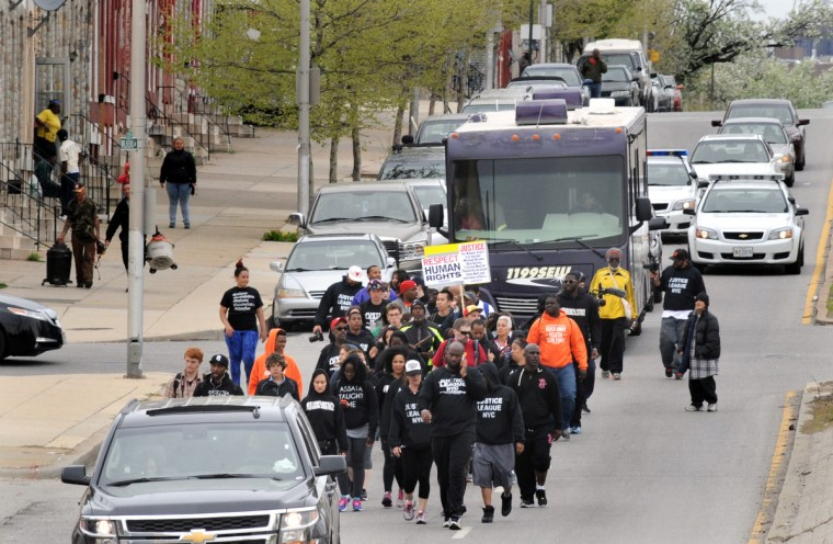 Members of the Justice League of NYC walk along Wilkens Ave. in West Baltimore on April 19th to protest the police custody death of Freddie Gray. (Algerina Perna/Baltimore Sun)