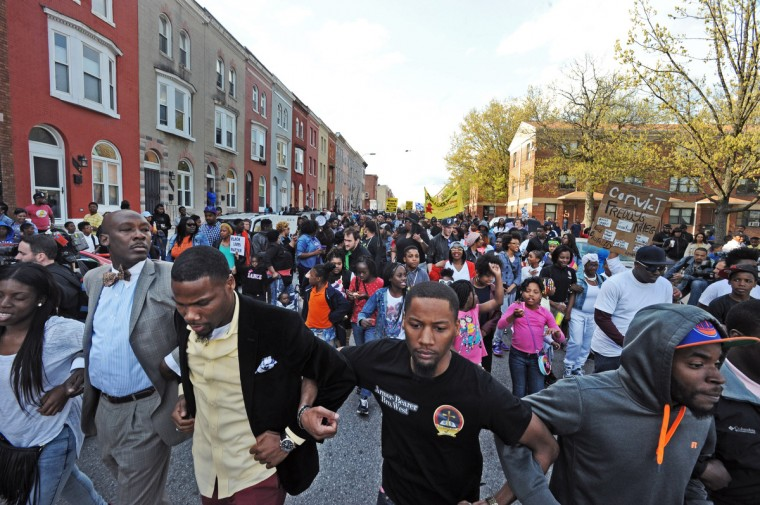 About 600 protestors including the family of Freddie Gray protested his death while in the custody of Baltimore police by marching from the site of the arrest, the corner of N. Mount and Presbury streets, to the Western District station about six blocks away.  (Kenneth K. Lam/Baltimore Sun)