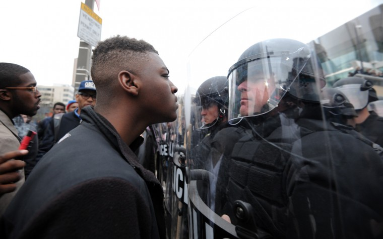 Police and protestors line up against each other across from the Sports Legends Museum as protests continue on April 25 in the wake of Freddie Gray's death while in police custody.  (Algerina Perna/Baltimore Sun)