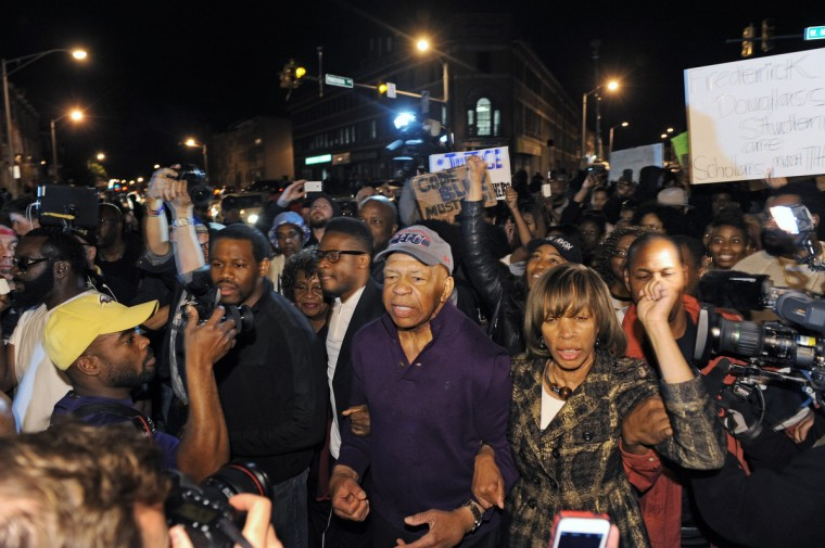 Congressman Elijah Cummings, center, and state Senator Catherine Pugh, right, led a group of demonstrator out of North and Pennsylvania Avenues ahead of the 10 p.m. curfew. Hundreds of people gathered at North and Pennsylvania Avenues to celebrate the news that six Baltimore City police officers have been charged for the death of Freddie Gray while in police custody. (Kenneth K. Lam/Baltimore Sun)