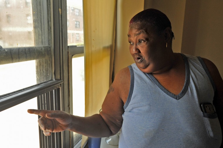 Jacqueline Jackson, 53, lives in a Gilmor Homes apartment that overlooks the 1600 block of North Mount Street, just north of the intersection with Baker Street. She witnessed from this window the police interaction with Freddie Gray on April 12. (Amy Davis/ Baltimore Sun)