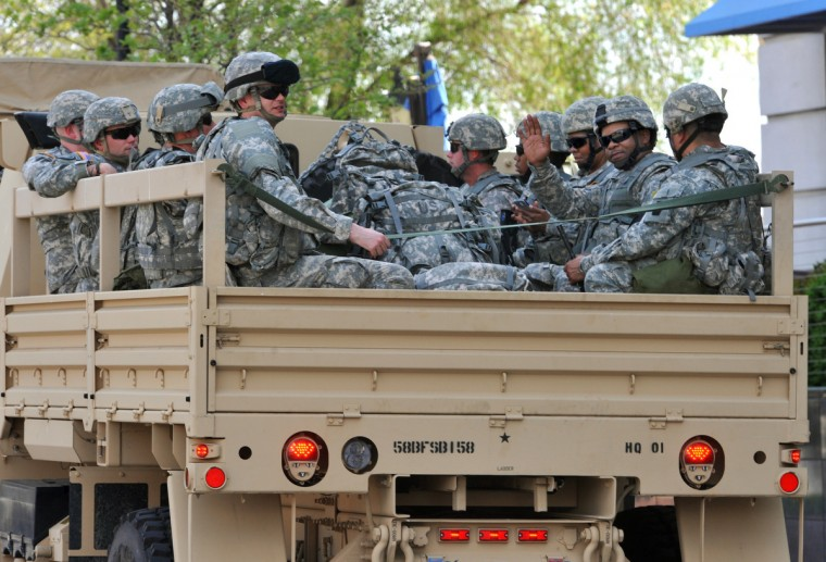 Maryland National Guard prepare to leave Baltimore in their trucks in Harbor East on Sunday afternoon. (Amy Davis/ Baltimore Sun)