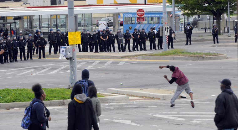 Police and protesters clash near Mondawmin Mall on Monday afternoon. (Lloyd Fox/Baltimore Sun)