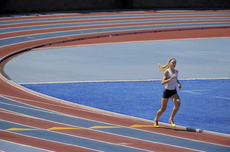 Katie Leisher of Manchester Valley HS opens a wide lead as her competitors which are nowhere to be seen, to win her event during the MPSSAA track and field finals at Morgan State University on 05/23/2015. (Karl Merton Ferron/BSMG)