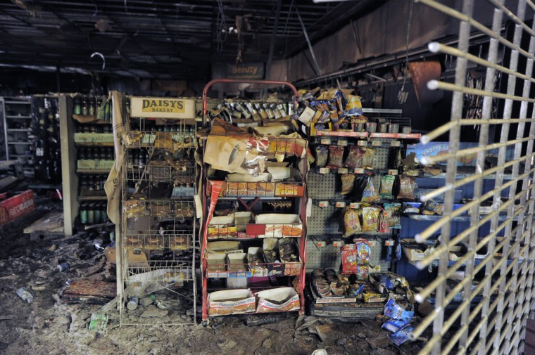 (The interior of the CVS pharmacy on West Franklin Street at Evergreen stands as a burnt shell after being hit during Monday's rioting. (Karl Merton Ferron/Baltimore Sun)