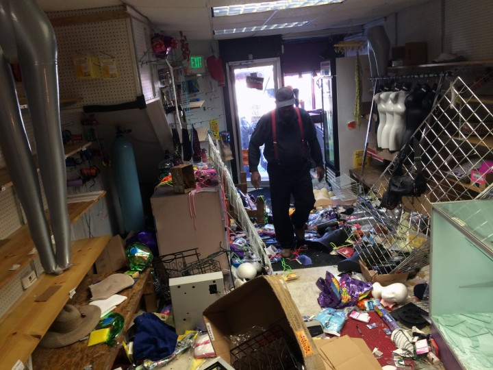 Store owner Otis Knight walks through Variety -n- Cellphone Center, which was breached overnight by looters and rioters on Fulton Avenue south of North Ave. (Karl Merton Ferron/Baltimore Sun)