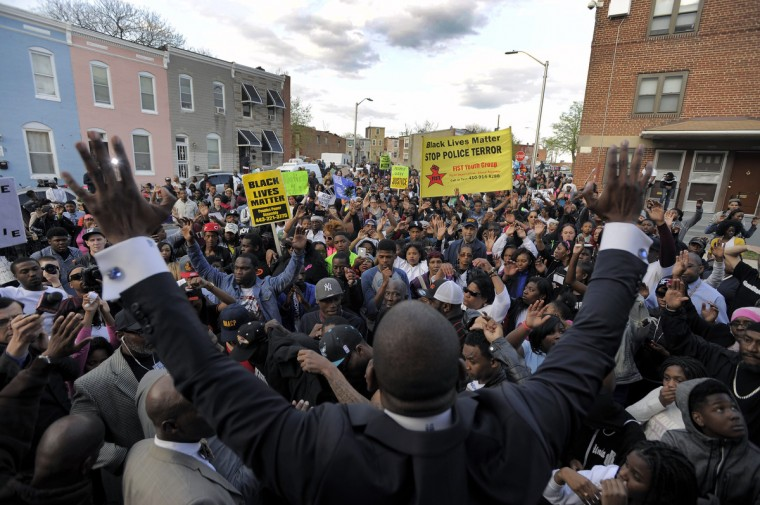 Protesters return to the spot as Rev. Jamal Bryant reaches his hands skyward while the family grieves where Freddie Gray was last seen alive in public. (Karl Merton Ferron/Baltimore Sun)