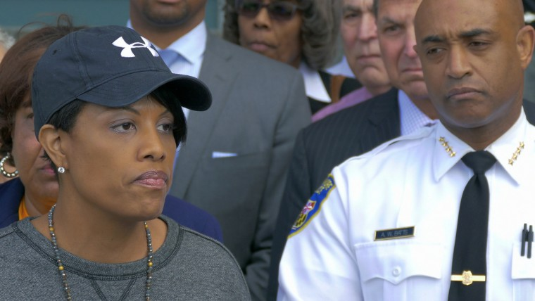 Civic leaders stand behind Baltimore Mayor Stephanie Rawlings-Blake (left) and Baltimore Police Commissioner Anthony Batts who address the media following an uprising that resulted in numerous injuries, arrests and fires. (Karl Merton Ferron/Baltimore Sun)