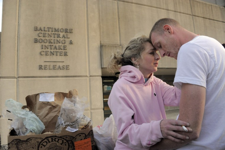 Rachel Fisher of Baldwin reacts as she is held by her boyfriend Andrew Rickers of Bowie after she was released from central booking. (Karl Merton Ferron/Baltimore Sun)