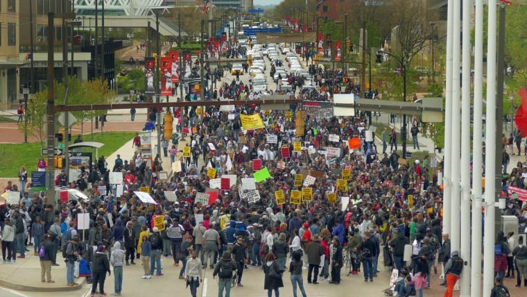 A large protest heads east on Pratt Street on the way to Baltimore's City Hall. (Karl Merton Ferron/Baltimore Sun)