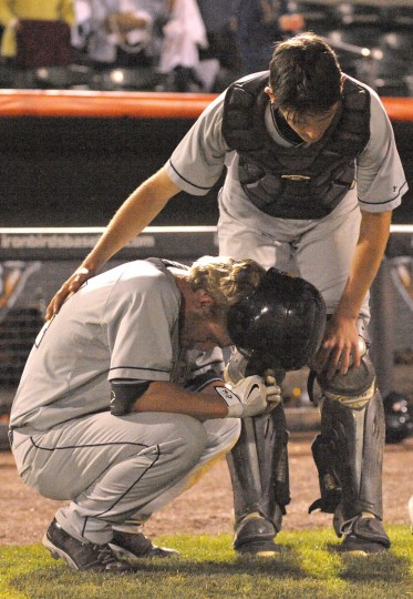 Severna Park's catcher Tyler Winship comforts teammate Brendan Clark after their loss to Gaithersburg during the MPSSAA State Baseball Championship held at Ripken Stadium in Aberdeen on Friday night, 5/22/2015. (Matthew Cole/BSMG)
