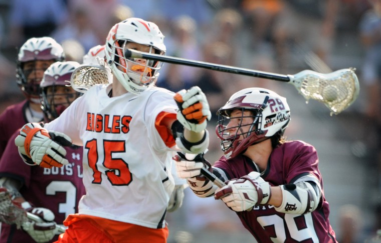 Boys' Latin's Luke Murray, right, checks the stick and ball away from McDonogh's Robby Black, left, in the third quarter. McDonogh defeated Boys' Latin by score of 13 t o 7 in the the 2015 semifinals of MIAA boys lacrosse championship at Homewood Field on 5/12/15. (Kenneth K. Lam/BSMG)