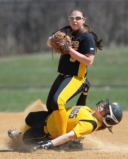 Northeast's Kirsten Midkiff prepares to throw after outing Mt. Hebron's Evvie Buehlman at second in the District V Spring Break Tournament at the Bachman Sports Complex in Glen Burnie.  (Joshua McKerrow/BSMG)