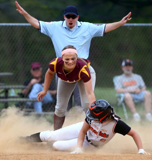 Sarah Heagy, bottom, of Eastern Tech slides safely into third base while Vanessa Hogan of Hereford defends during the Baltimore County championship game in Catonsville on Tuesday, May 5, 2015. (Matt Hazlett/BSMG)