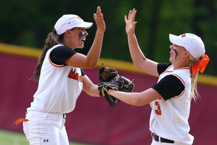 Brooke Samios-Uy, left, of Eastern Tech celebrates with her teammate Brooke Retkowski after turning a double play during the Baltimore County championship game in Catonsville on Tuesday, May 5, 2015. (Matt Hazlett/BSMG)