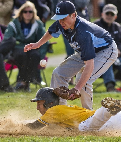 Mt. Hebron's Zack Stewart beats the tag and slides in safely for a steal of third base during the Howard High versus Mount Hebron High baseball matchup at Mt. Hebron in Ellicott City on 4/15/15. (Scott Serio, for BSMG)