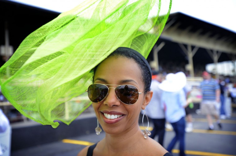 Metti Kanno, Baltimore, MD, attends her 4th Preakness donning a bright green hat. (Robert K. Hamilton/Baltimore Sun)