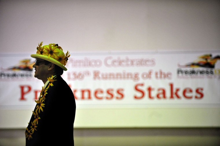 Cameron Fleming was decked out in Black-eyed Susans and hat during the 136th running of The Preakness. (Monica Lopossay/Baltimore Sun)