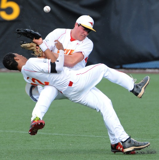 Second baseman Gabriel Nieto #12, front and outfielder Nate Bossse #19 collide as they both go after a fly ball in the second inning.  Archbishop Spalding High School plays Calvert Hall in baseball at Calvert Hall on 4/20/15.  (Algerina Perna/BSMG)