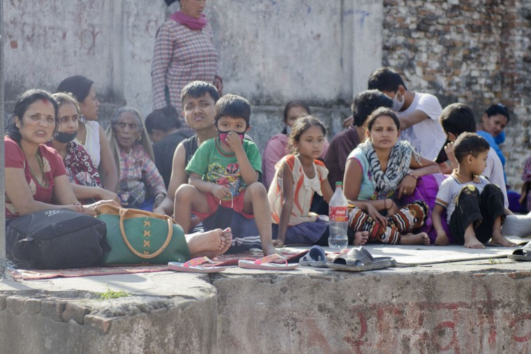 People started rushing into an open ground after a fresh 7.3-magnitude earthquake struck Kathmandu, Nepal on Tuesday, May 12, 2015. At least 42 people have been killed and 1,006 injured in the Himalayan country and neighboring states, as many buildings already weakened by a much bigger quake last month were brought down. The earthquake was centered 68 kilometers (42 miles) west of the town of Namche Bazaar, close to Mount Everest and the border with Tibet, the U.S. Geological Survey said. It could be felt as far away as northern India and Bangladesh. (Sumit Shrestha/Zuma Press/TNS)