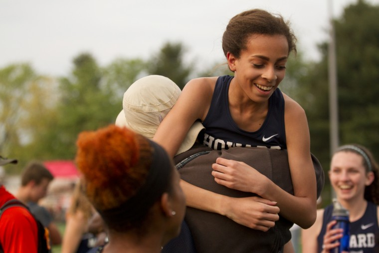 Howard coach Tyler Wade celebrates with runner Sherise Scott after the girls won the 4x400 meter relay during the Howard County Ooutdoor Track Championships at Wilde Lake High School in Columbia, MD on Tuesday, May 5, 2015. (Jen Rynda/BSMG)