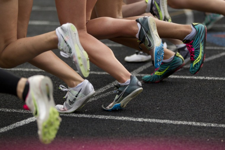 Girls take off at the start of the 800 meter run during the Howard County Ooutdoor Track Championships at Wilde Lake High School in Columbia, MD on Tuesday, May 5, 2015. (Jen Rynda/BSMG)