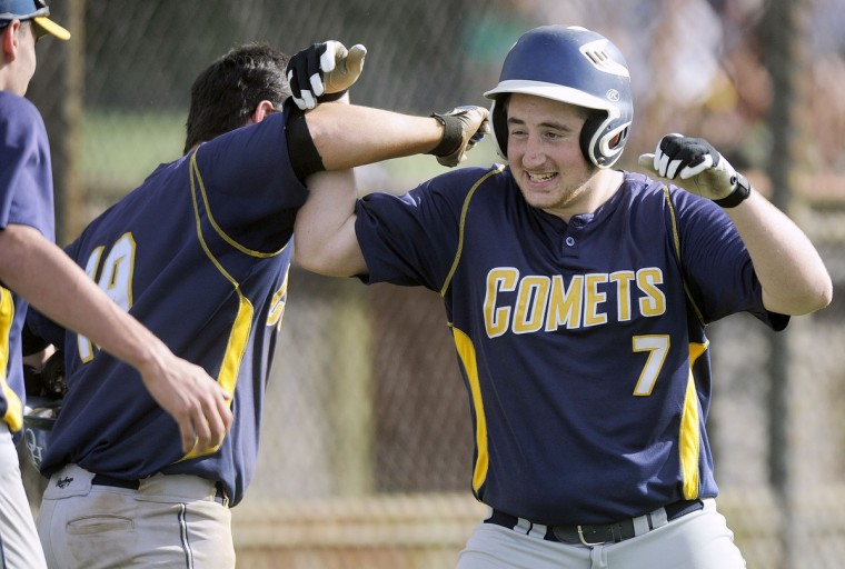 Catonsville's Danny Terzi, right, celebrates his home run with teammate Jack Harrell in the fifth inning of a high school baseball regional semifinal against Perry Hall Monday, May 11, 2015 in Perry Hall. (Steve Ruark/for BSMG)