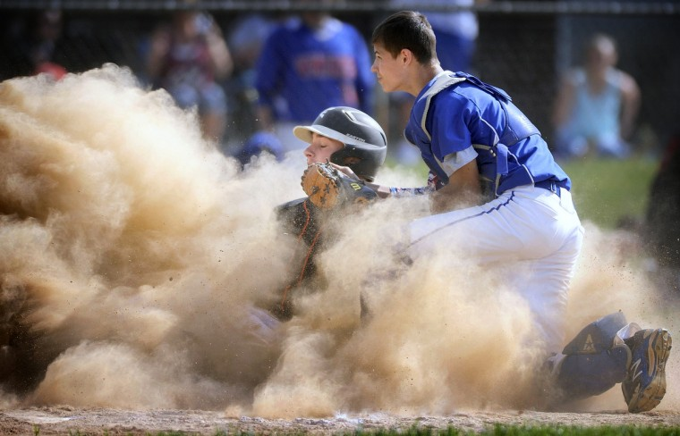 Eastern Tech's Riley Hodge, left, slides safely into home plate as Lansdowne catcher Austin Tucker applies a late tag in the second inning of a high school baseball regional final Friday, May 15, 2015 in Essex. (Steve Ruark/for BSMG)