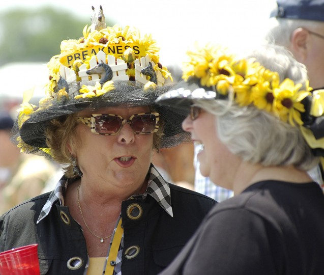 Sharon Garry (big hat) from Ellicott City makes hats every year for herself and also did the one for her friend Darlene Peterson from Westminster both have come 6 years with friends to see the horses and have fun for the day. (Brendan Cavanaugh/P3 Imaging)