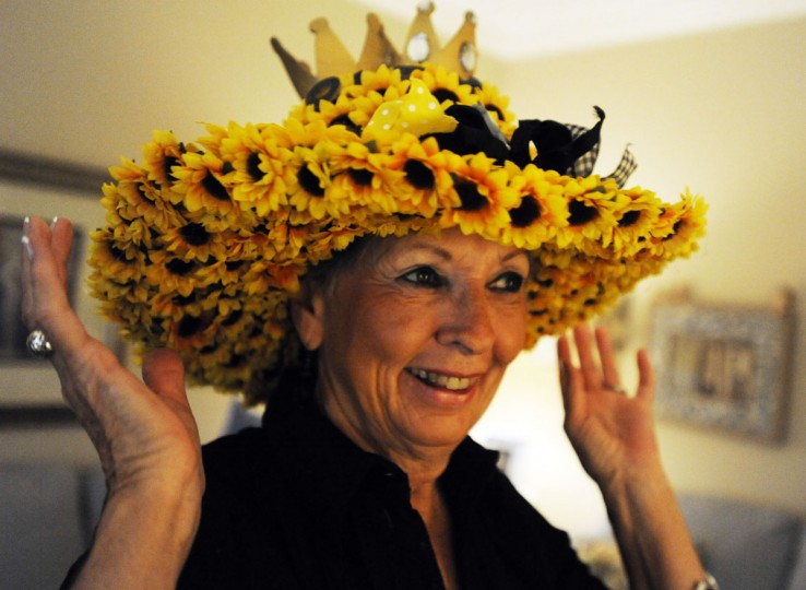 Colleen Maclean, of Catonsville, tried on one of Sharon Garry's famous Preakness hats. (Noah Scialom)