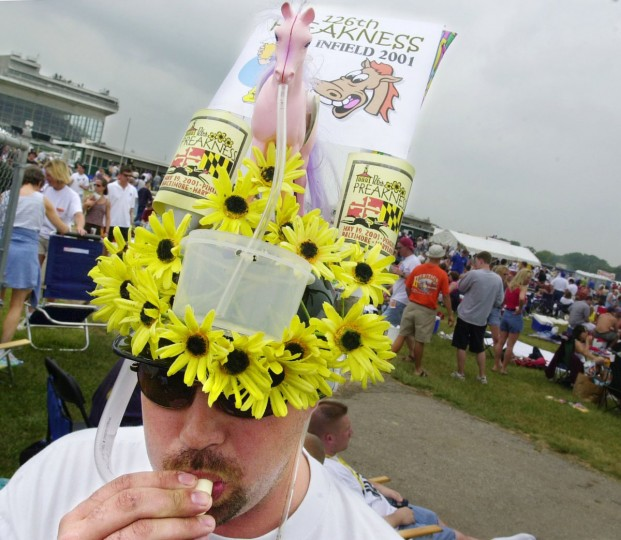 Robert Morningstar displays his home made hat made with a plastic horse and Blackeyed Susans. (Lloyd Fox/Baltimore Sun)