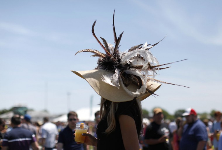 A race fan with a hat is pictured before the 137th running of the Preakness Stakes at Pimlico Race Course in Baltimore, Maryland May 19, 2012.(Kevin Lamarque/Reuters)