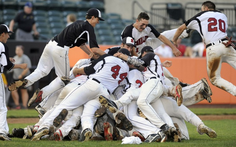 Archbishop Spalding celebrates after beating Calvert Hall 4-1 in the MIAA A Conference baseball championship at Ripken Stadium in Aberdeen Sunday, May 17, 2015. (Steve Ruark for BSMG)