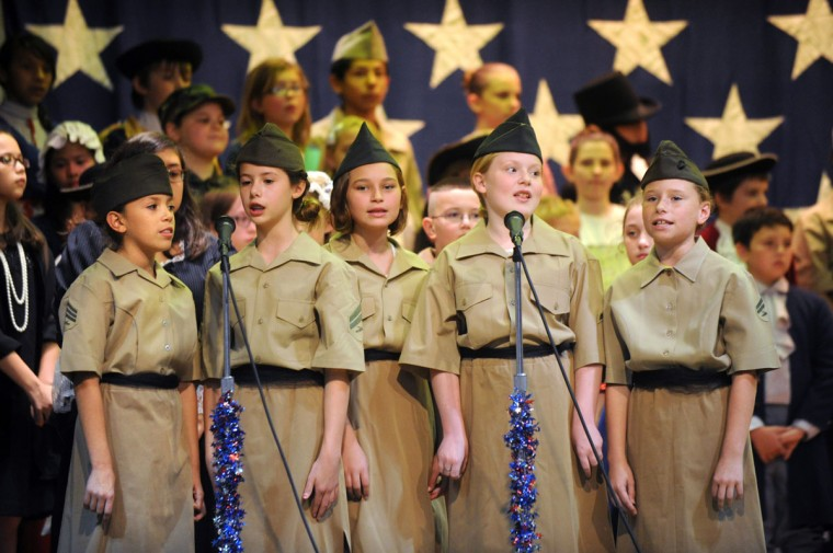 Students from Dyess Elementary School perform on stage in the annual I Love America program Friday, May 22, 2015, in Abilene, Texas. (Nellie Doneva/The Abilene Reporter-News via AP)