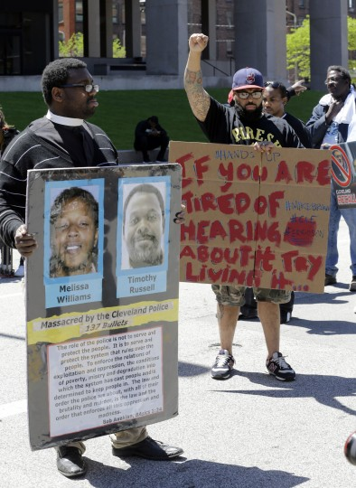 Protesters stand outside the courthouse after the Michael Brelo verdict in Cleveland. Brelo, a police officer charged in the shooting deaths of two unarmed suspects, Timothy Russell and Malissa Williams, during a 137-shot barrage of gunfire was acquitted. (Tony Dejak/Associated Press)