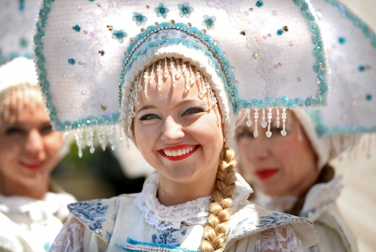 "Katia Brovkina of the Russian song and dance ensemble, ""Barynya,"" waits to perform at the seventh annual Troika Russian Festival at the Church of the Nativity in Erie, Pa. (Jack Hanrahan/Erie Times-News via AP)"