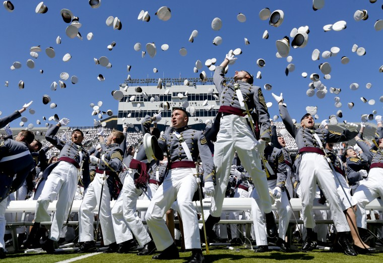 Graduates from the U.S. Military Academy toss their hats into the air after a graduation and commissioning ceremony in West Point, N.Y. (Mike Groll/Associated Press)