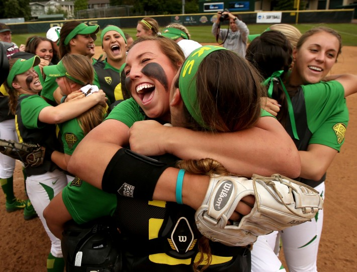 Oregon's Cheridan Hawkins, front left, celebrates with teammates after sweeping North Carolina State to win an NCAA college Super Regional softball game in Eugene, Ore., Saturday. (Chris Pietsch/The Register-Guard via AP)