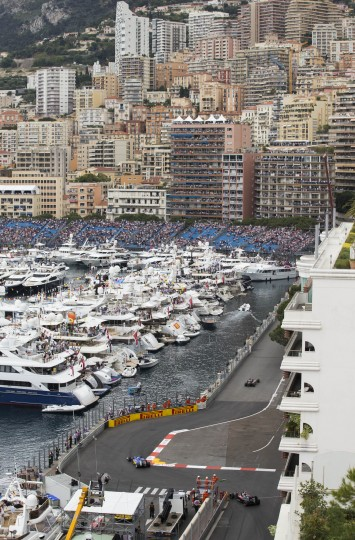 Formula one racing cars take the harbor chicane during the Qualifying session at the Monaco racetrack, in Monaco. The Formula One Grand Prix of Monaco will be held on Sunday. (Gero Breloer/Associated Press)