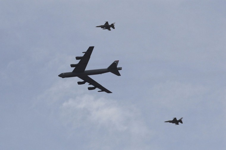 A U.S. strategic bomber B-52 and two Jordanian F-16 aircraft participate in 18-nation military exercises in a field near the border with Saudi Arabia, in Mudawara, 280 kilometers (174 miles) south of Amman, Jordan, Monday, May 18, 2015. (AP Photo/Raad Adayleh)