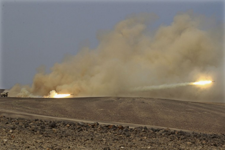 "Rockets are fired during 18-nation military exercises in a field near the border with Saudi Arabia, in Mudawara, 280 kilometers (174 miles) south of Amman, Jordan, Monday, May 18, 2015. Some 10,000 troops took part in the two-week ""Eager Lion"" exercises hosted by Jordan for the fifth year. (AP Photo/Raad Adayleh)"