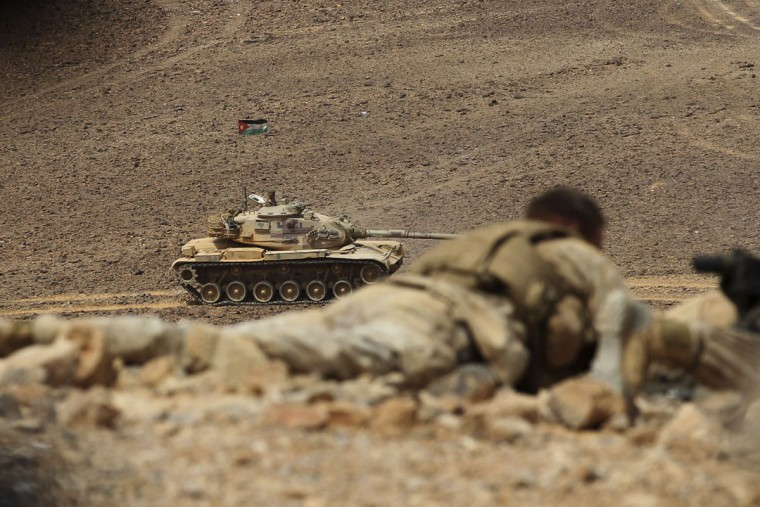 "A Jordanian tank advances during 18-nation military exercises in a field near the border with Saudi Arabia, in Mudawara, 280 kilometers (174 miles) south of Amman, Jordan, Monday, May 18, 2015. Some 10,000 troops took part in the two-week ""Eager Lion"" exercises hosted by Jordan for the fifth year. (AP Photo/Raad Adayleh)"