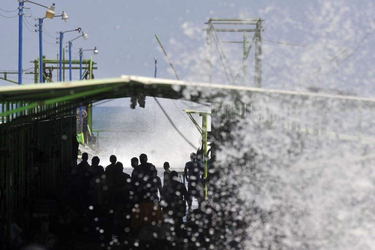 Fishermen observe the waves in La Libertad, 34 km south of San Salvador, on May 3, 2015. (Marvin RECINOS/AFP/Getty Images)