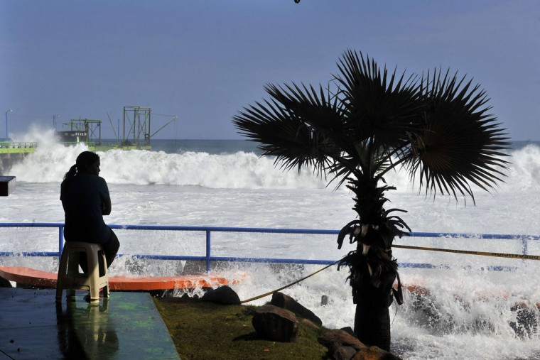 A woman looks at the waves in La Libertad, 34 km south of San Salvador, on May 3, 2015. (Marvin RECINOS/AFP/Getty Images)
